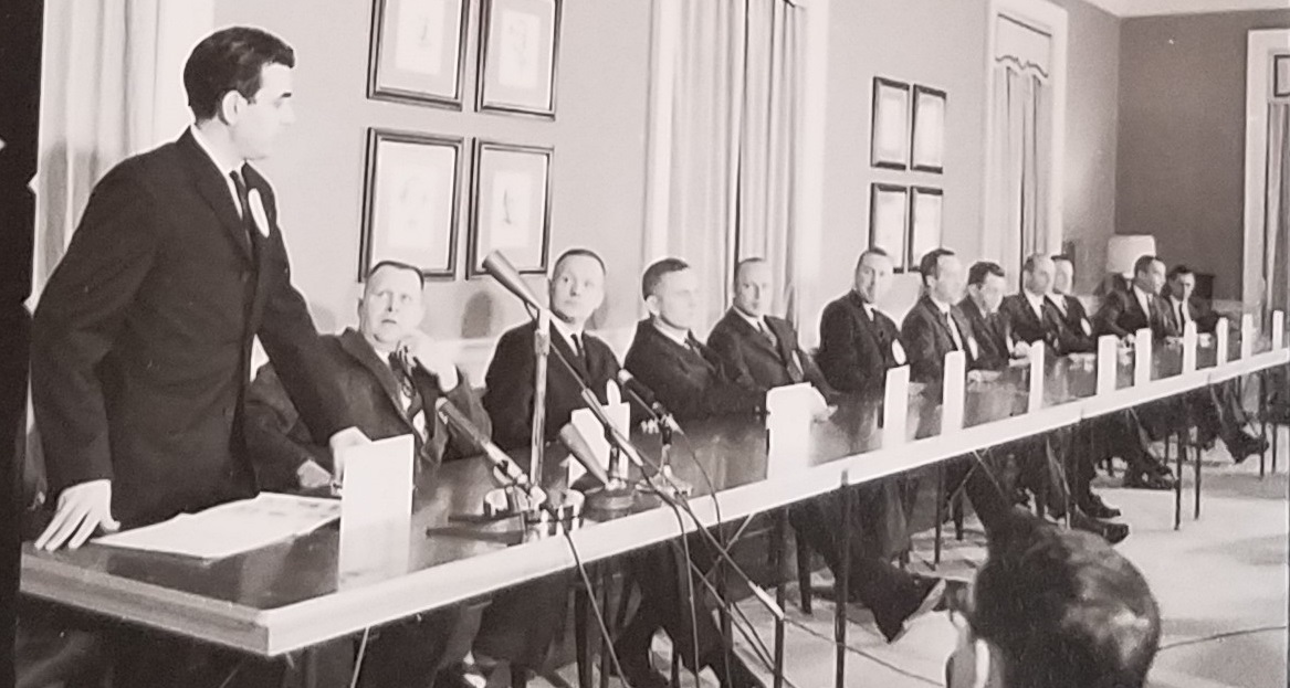 NASA press conference with New Nine astronauts and NASA officials in 1963. Photo courtesy of UNC Photographic Laboratories and Morehead Planetarium and Science Center Archives.